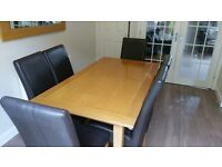 6 Brown leather High backed Chairs and extending Oak dining table with mirror