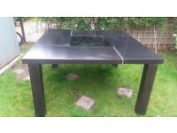Huge modern square table with a movable black glass in the middle. Very solid and heavy.