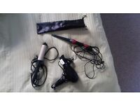 2 curling irons and a hair dryer