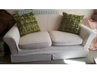 Cream 2 seater settee with two sets of washable stretch covers (Pick up from Fairwater)