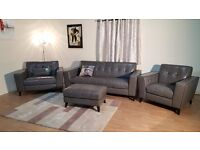 Ex-display Rally grey leather buttoned back 3 seater sofa, snuggler chair, standard chair and puffee