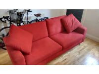 Contemporary red three-seater sofa / settee
