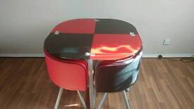 Glass round dinning table and 4 chairs