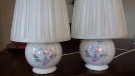 Pair of Aynsley sweet pea design lamps with cream shades.