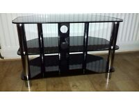 Black Glass and Chrome TV Stand . 80cm wide , 53cm high , 45cm deep . £25 . BT5