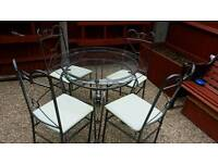 Metal glass top table and 4 chairs