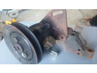 Ford sierra cosworth power steering pump with bracket complete will fit 3 door cosworth also