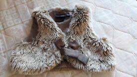 Next fur coat sleevless...like new