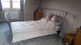 Metal frame double bed very good condition top of mattress never been slept on