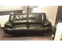 Black leather 3 seater sofas x2
