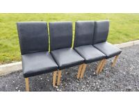 4 black leather chairs