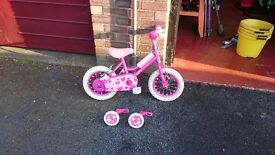 little girls bike with stabilisers and basket