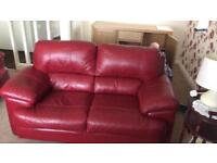 Red leather sofa chair and storage foot stool