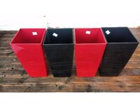 Excellent condition Lechuza planters in gloss red or black. 57cmx30cm