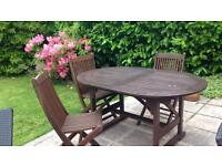 Solid wood garden table and 3 chairs
