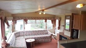 lovely preowned static caravan for sale on an 11 month site. pet friendly close to the beach