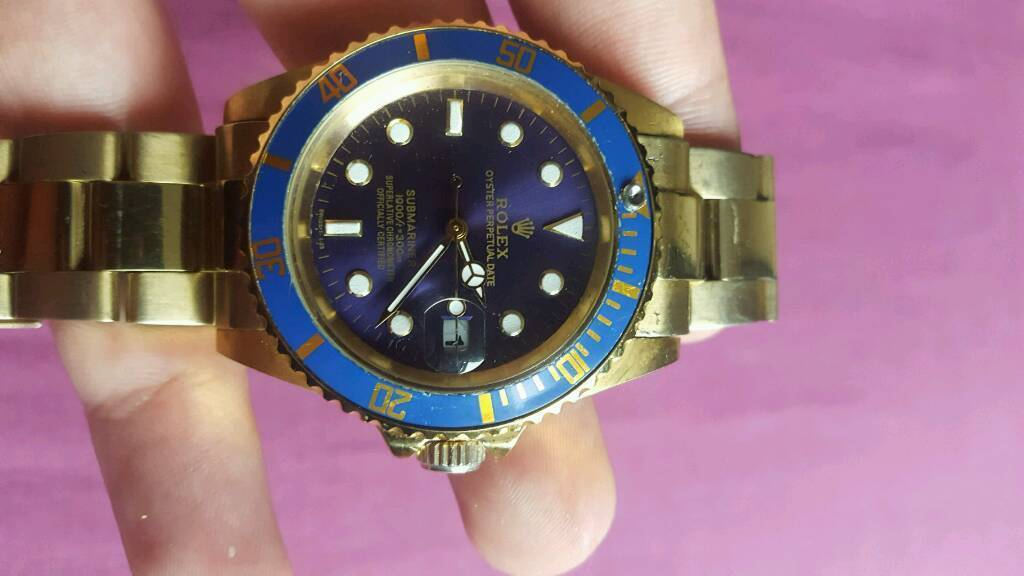 Gold and blue submariner rolexin Redcar, North YorkshireGumtree - Gold and blue.Couple scratches but cant notice them.Dont need batterys it charges it self when the watch is moving