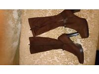 Bundle of Boots . One size 7 brown new and the rest size 8 used, 2 cream and 1 black