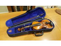 1/2 size violin. Well-worn with pleasant tone.
