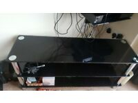 Free to collect. Black glass tv stand and accompanying side table. Pristine condition