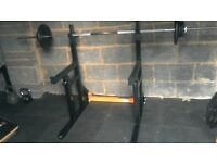 SQUAT RACK & BENCH WITH 7ft BAR & CAST IRON PLATES. HEAVY DUTY. PERFECT CONDITION. £100