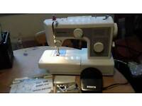 Riccar 650 free arm electric sewing machine with accessories