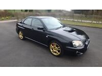 vTidy Subaru Impreza WRX, reconditioned engine, stainless exhaust, race dynamics tune, black n gold
