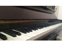 Upright piano in good condition - Selfridges Arlington