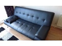 Faux leather sofa bed. Modern style