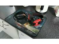 Backlit PC gaming headset and oversized gaming mouse mat