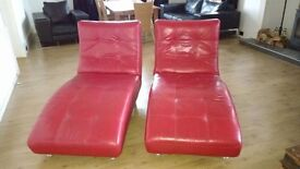 2 red leather chaises