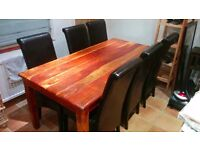 Mahogany dining table and 6 black chairs