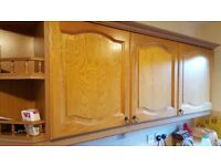Oak kitchen with wall units, sink, oven, hob, extractor fan and worktop