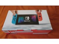 Nintendo Switch Console Neon (red,blue) 32gb and Mario Odyssey BRAND NEW SEALED.