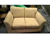 Small neutral coloured sofa