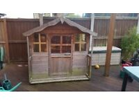 Wooden playhouse for sale for £20. Buyer collect. Height is 114cm and width is 147cm.