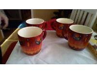 poole pottery mugs