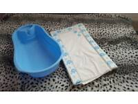 Baby bath tub + changing mat