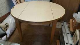 Oak round dining table and unique tailor made folding table pad
