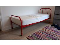 Beautiful shiny red, metal frame, 6ft x 2.5ft bed with mattress and sheets