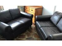Two identical IKEA faux leather two seater sofas