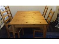 Pine coloured dining table and chairs
