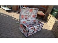 Trunk - recovered in material, suitable for storage such as towels, etc.