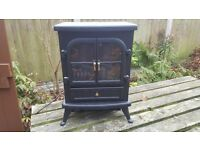 Electric fire modern in old style. 2 years old, rarely used works perctly.