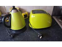 Matching green kitchen kettle and toaster
