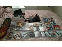 Playstation 3 with 26 games and skate board