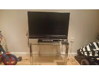 32 inch Sony television for sale. Also selling glass stand. Will sell as a package or individually