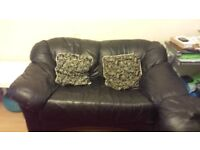 Leather black sofa (pillows included)