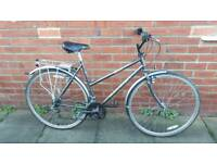 Ladies Raleigh Hybrid bike. Excellent condition. 21 inch frame. 12 speed. Ready to ride