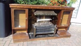 Electric fire in a wooden surround